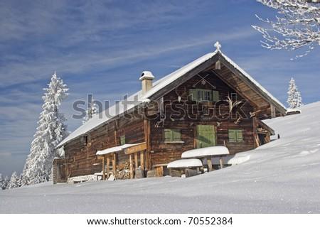 Alpine hut in winter - stock photo