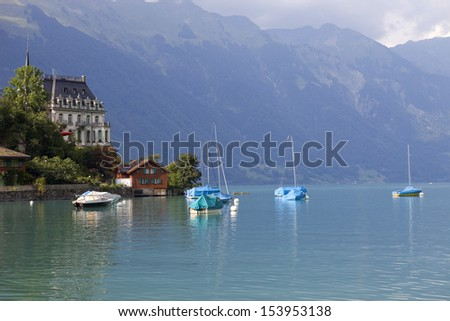 Alpine lake Brienz of Jungfrau region, viewed from Iseltwald in Switzerland - stock photo