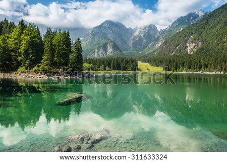 alpine lake Di Laghi Fusine . Dolomites . Italy - stock photo
