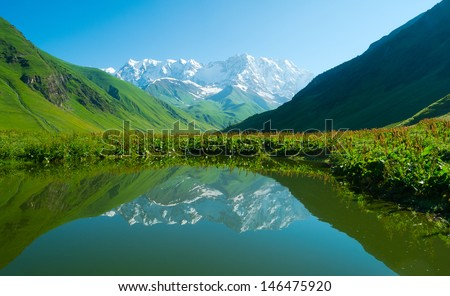 Alpine lake near Ushguli, Svaneti, Georgia. Shkhara mountain in the background