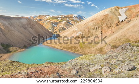 Alpine Lake, rhyolite mountains, Laugarvegur Trail (a.k.a. Laugavegurinn), near Landmannalaugar, Fjallabak Nature Reserve, Iceland - stock photo