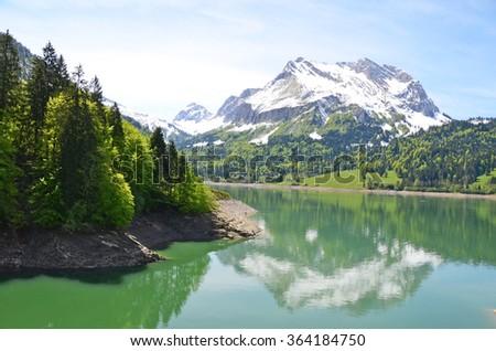 Alpine lake, Switzerland - stock photo