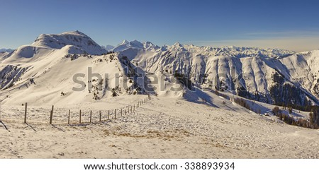 Alpine landscape panorama in winter. Concept of clean and untouched nature.