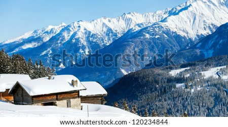 Alpine landscape. Snow-covered house, forest, mountains. Panorama. Zell am Ziller, Tirol, Austria - stock photo