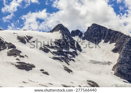 Alpine landscape - snow in summer - stock photo