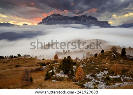 Alpine landscape with blurred fog and coming storm, Dolomites, Italy - stock photo