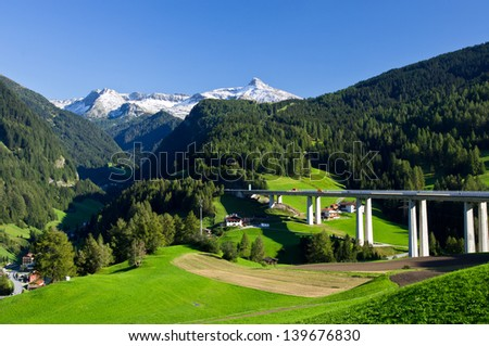 Alpine landscape with motorway pass between Austria and Italy - stock photo