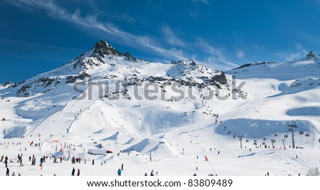 Alpine mountain and people on slopes