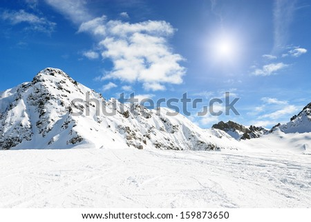 Alpine mountains under the snow in winter - stock photo