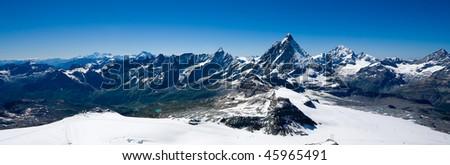Alpine panorama with Matterhorn - stock photo