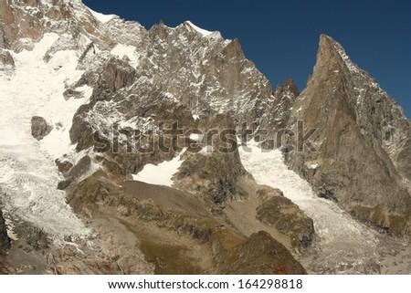 alpine peaks above Val Veny - stock photo