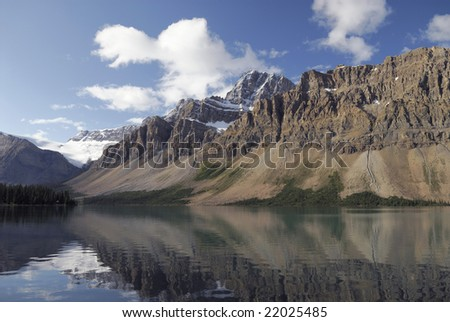 Alpine reflections in Bow Lake in Banff National Park, Canadian Rockies