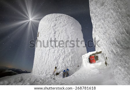 Alpine ridge Montenegro - stands on the slopes of the Ukrainian Carpathians ancient observatory  against a background of deep snow peaks and bitter cold strong wind waiting climber - extremals - stock photo