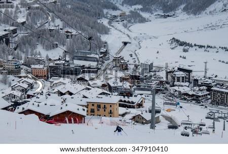 Alpine scenery. View to Breuil-Cervinia fron the ski tracks. Aosta, Italy, January 2013 - stock photo