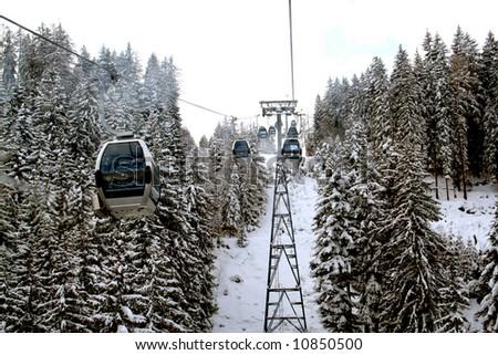 Alpine skilift in snowy Swiss alps mountains - stock photo