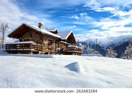 Alpine snow cabin  - stock photo