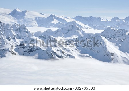 Alpine snow covered peak in the Alps at winter - stock photo