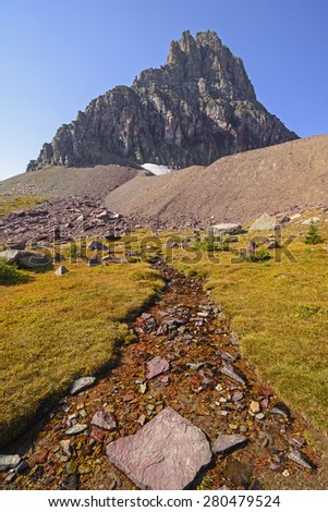 Alpine Stream Below Clements Mountain near Logan Pass in Glacier National Park - stock photo