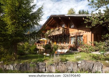 Alpine traditional hut, hotel, chalet, refuge, Via Alpina trail, Switzerland - stock photo