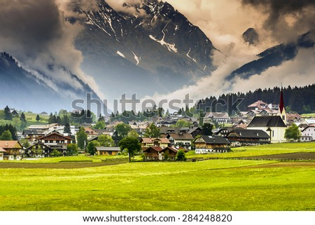 Alpine village in Dolomites, Italy  - stock photo