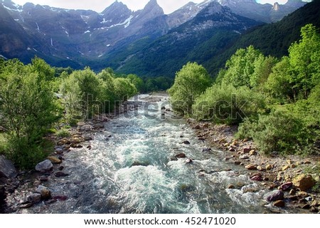 Alpine watercourse along the Pineta Valley and Monte Perdido in Spain