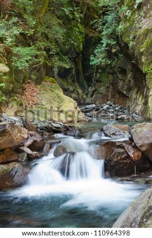 Alpine waterfall with motion blur - stock photo
