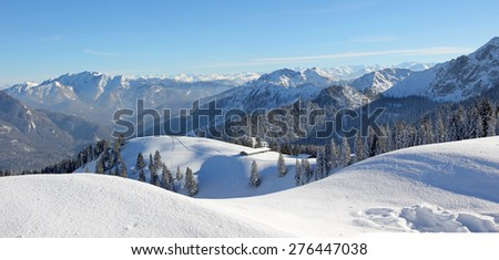alpine winter landscape, snow covered skiing area upper bavaria - stock photo