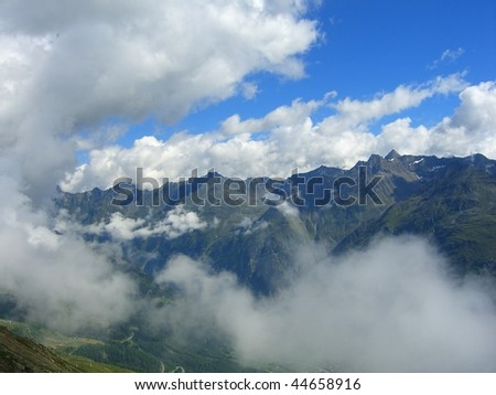 alpines view with snow and clouds