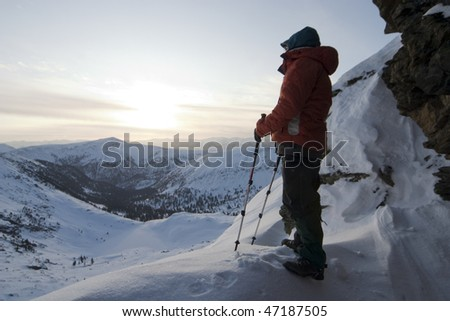 Alpinist in mountains take a rest.
