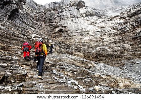 Alpinists climbing Eiger Peak, Berner Oberland, Switzerland - UNESCO Heritage - stock photo