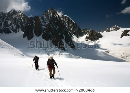 Alpinists traversing Mer de Glace, France, Europe - stock photo