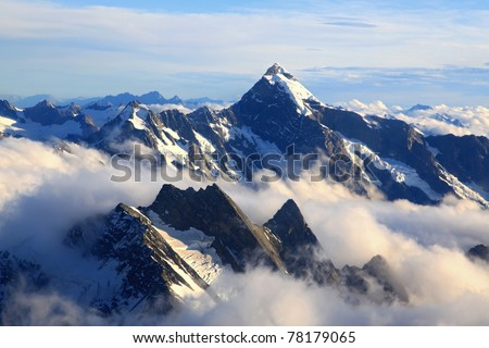 Alps Alpine Landscape of Mountain Cook Range Peak with mist from Helicopter, New Zealand