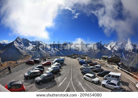 ALPS, AUSTRIA - OCTOBER 2, 2013: Picturesque alpine road Grossglocknershtrasse. Parking. Photo taken by lens Fisheye