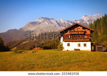 Alps in Austria. Dachstein mountains - generic village Annaberg im Lammertal, alpine town. Filtered style colors. - stock photo
