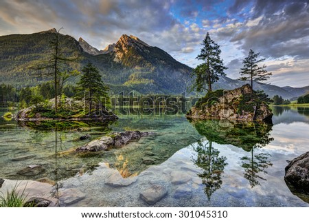 Alps, lake Hintersee in first light (in July). - stock photo
