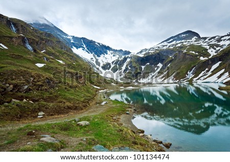 Alps mountains tranquil summer view (reflections on the lake  near Grossglockner High Alpine Road)