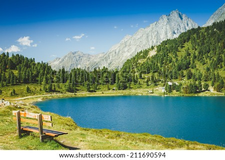 Alps summer mountain landscape with lake. Time for break  - stock photo