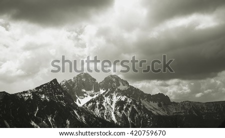 Alps - Wonerful view of snowy mountains and blue sky with clouds. Pizzo Camino, Bergamo Prealps, Italy - stock photo