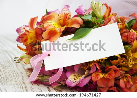 alstroemeria flowers with a white card for a message.