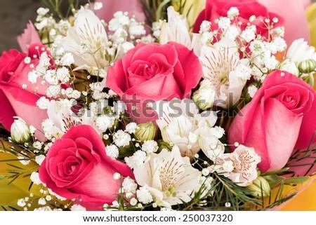 Alstroemerias and garden roses in fresh bouquet - stock photo