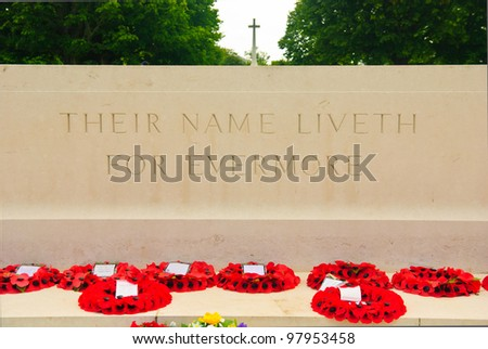 Altar with cross and flowers on the British war cemetery in Bayeux, Normandy, France - stock photo