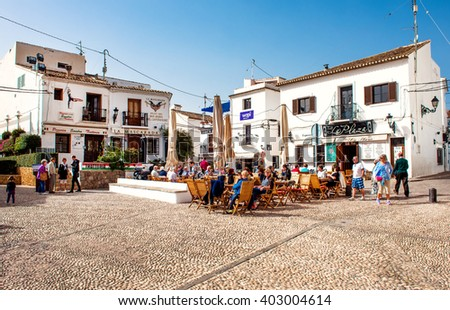 Altea, Spain- February 22, 2016: Tourists sitting in a sidewalk cafe on a main square of Altea town. Altea is a most beautiful place in the Costa Blanca. Spain