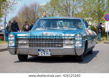 ALTENTREPTOW / GERMANY - MAY 1, 2016: Cadillac Coupe de Ville  drives on street at an oldtimer show in altentreptow / germany on may 1, 2016. - stock photo