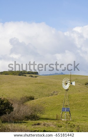 Alternate energy - Wind powered pump with solar panel for the days when there is no wind in central California