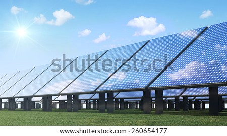 Alternative Energy Concept. Modern Solar Panels Farm on beautiful Green Grass with Sunshine and Clouds