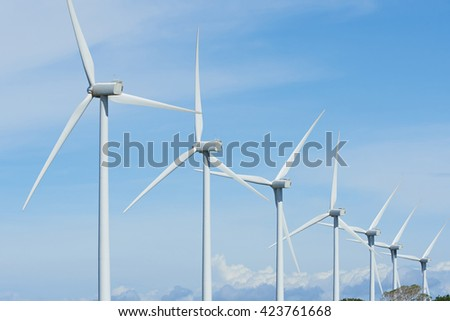 alternative energy from wind generator on blue sky
