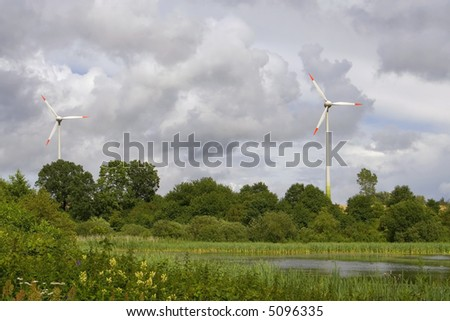 Alternative energy. Modern wind turbines creating renewable energy.