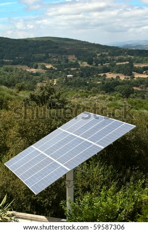 Alternative energy; Photovoltaic panel in the rural landscape - stock photo