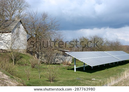 Alternative energy source in the countryside - stock photo