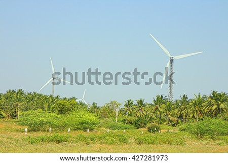Alternative energy sources 8. Wind farm in Indian province Kerala. Many wind-powered generators stand opposite to mountainous terrain
